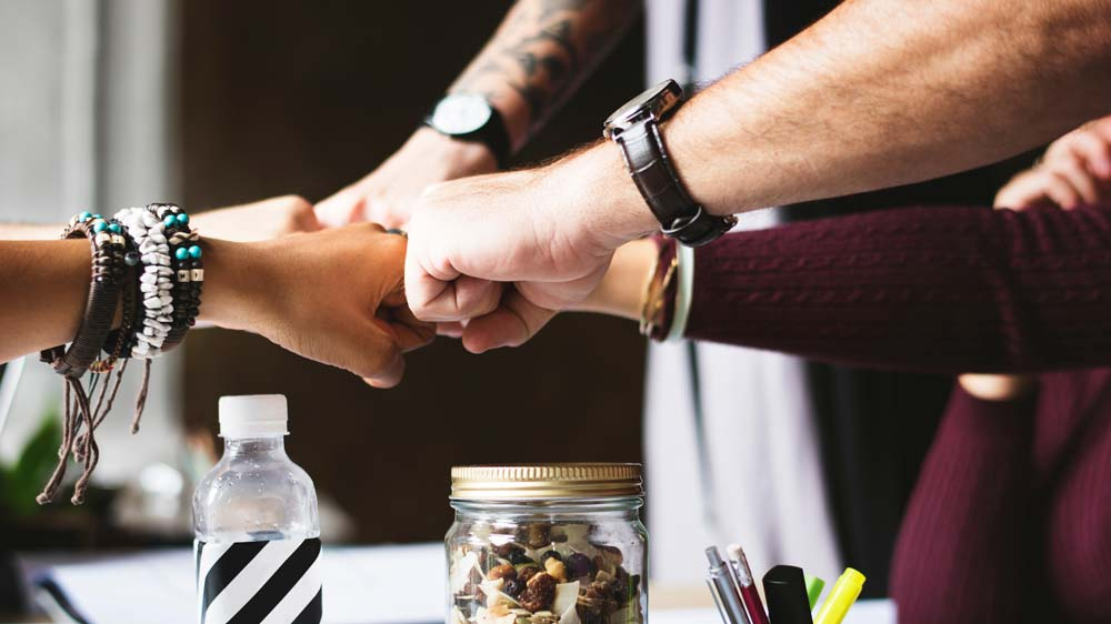 Fundraising teamwork - Pengene er i hus